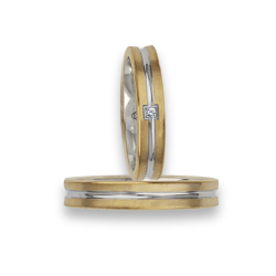 Fedi nuziali bicolore oro 18kt giallo e bianco con un diamante modello bi242524