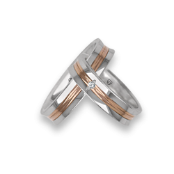 Wedding rings in white and rose gold holloved surface with a diamond model ap055524