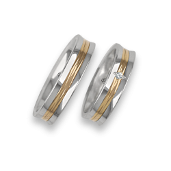 White and yellow bicolour wedding rings concave and polished surface with one diamond model al055524
