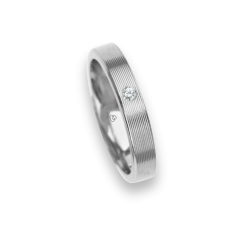 18 carat white gold ring / wedding ring polished finish and carved at the sides one diamond model ab3389dw