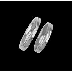 Fedi nuziali oro bianco con canale centrale a forma di coda di balena. Nove diamanti. Modello vb534544