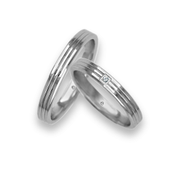 Diamond white gold wedding bands, polished finish, two central canals. Model ab0339