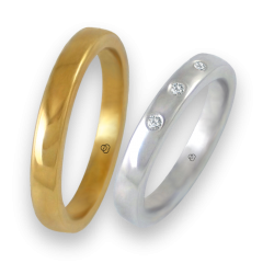 Wedding bands in yellow and white gold 18 k slightly rounded surface three diamonds model g-ab5.3-632