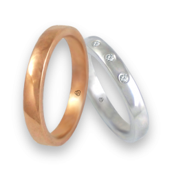 Wedding rings in rose and white gold 18k. Polished finish with three diamonds. model q-ab5.3-632