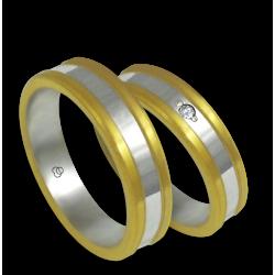 Fedi in oro giallo e bianco con un diamante modello bi054624