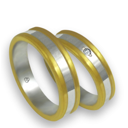 Wedding bands in yellow and white gold with 1 diamond model bi054624