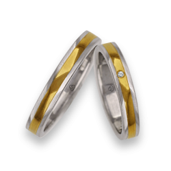 Wedding rings in yellow and white gold polished and satin finish with a diamond model kl5350