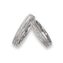 wedding bands in white gold 18k with diamond point patterns at the center model ra343922