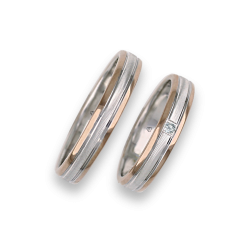 Wedding bands in rose and white gold whith one diamond model wo045324