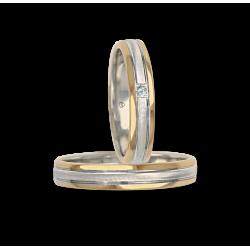 Fedi nuziali in oro giallo e bianco con un diamante modello wi045324