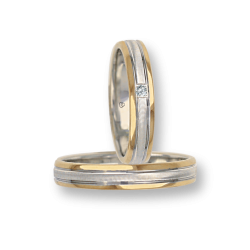 Wedding rings in yellow and white gold with one diamond model wi045324
