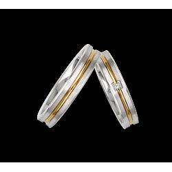 Fedi nuziali in oro bicolore bianco e giallo con un diamante modello bl242524